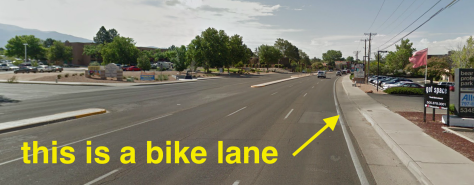 According to the CABQ bike map, this is a bike lane on Wyoming between Osuna and Academy.