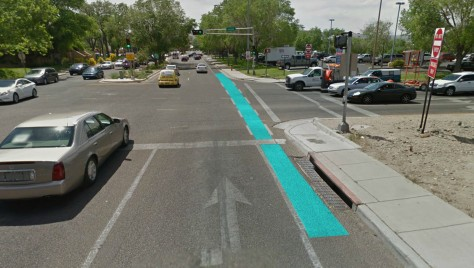 A rendering of what turquoise bike lanes could look like on MLK and I-25, westbound.