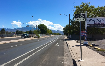 This section of Zuni, between Washington and San Mateo, went from 3 lanes in each direction to 2 lanes in each direction + wide, buffered bike lanes. The majority of the corridor, from San Mateo to Central, went from 2 lanes in each direction to 1 lane in each direction + a center turn lane + bike lanes on each side.